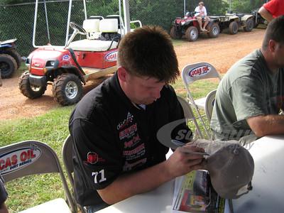 Wayne Chinn signs an autograph