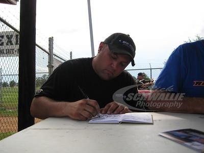Scott James signs an autograph