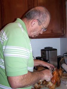 Grandpa carves the turkey