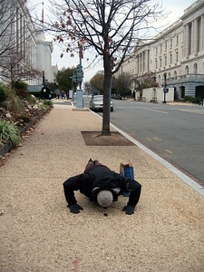 Avram stops to do pushups on First Street