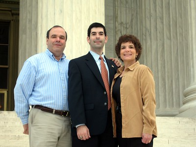 David and parents, on the steps of the Supreme Court