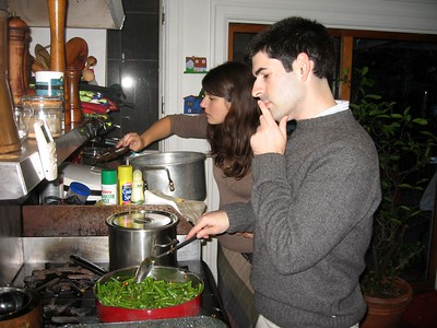David thoughtfully prepares the green beans.