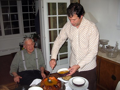 Avram serves the pumpkin soup while his father, Wallace, looks on.