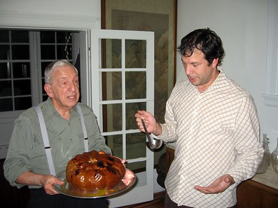 Avram prepares to serve the pumpkin soup, presented by his father, Wallace.