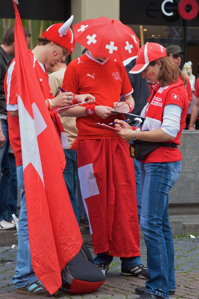 They're all writing a 300-word essay on 'Why I should win the most all-out Switzerland supporter'.