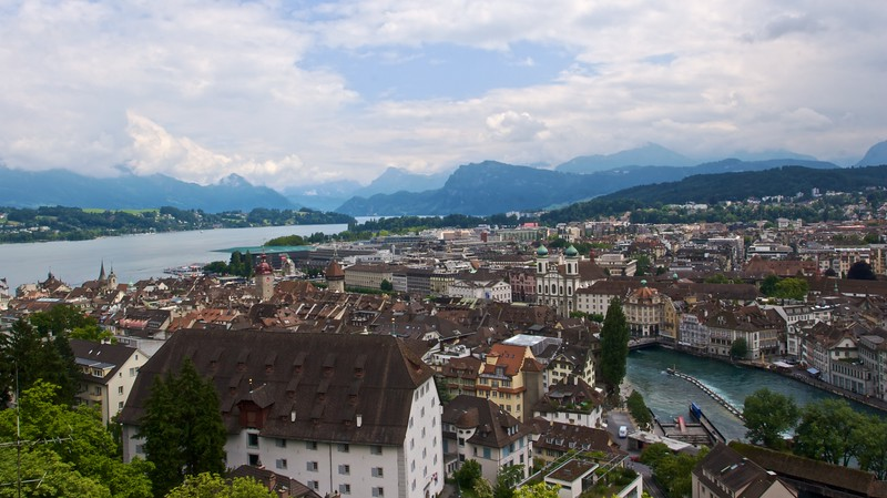 View over Lucerne • Lucerne as seen from the top of the Männliturm, one of the towers of the city's battlements. Lake Lucerne is on the left; the river Reuss is on the right.
