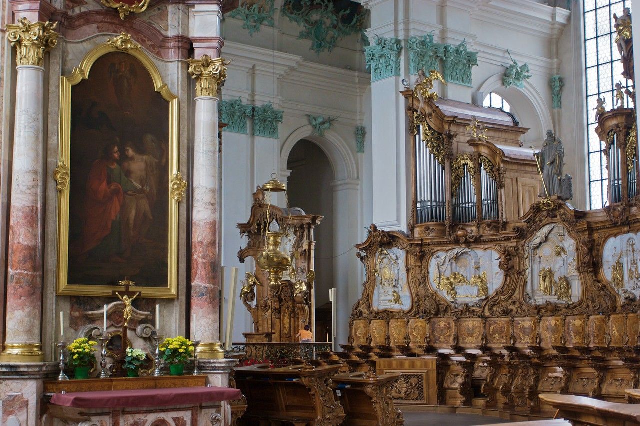 Choir stalls • A view behind the wrought-iron rood screen inside St Gall cathedral, on the sanctuary.