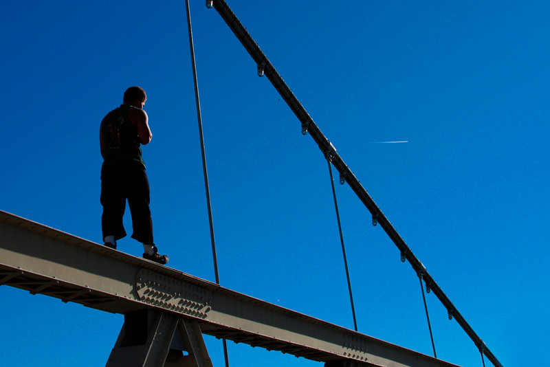 Kelsey takes his own route across the suspension bridge.