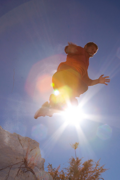 Kelsey leaps from a chunk of hardened gypsum and touches the sun before coming back to earth.