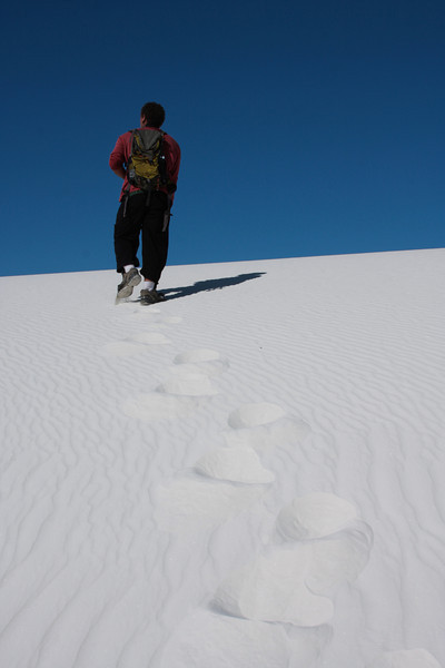 Kelsey makes tracks for the top of another dune.