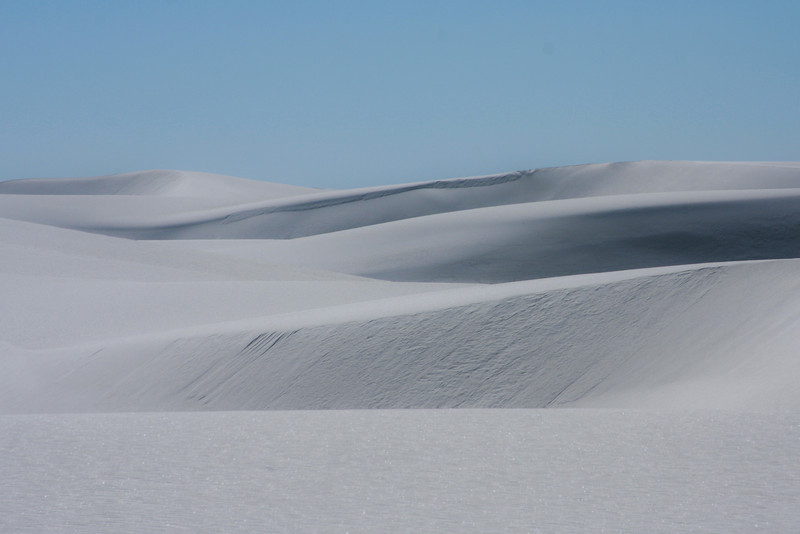 Sand dunes wander away forever into the distance.