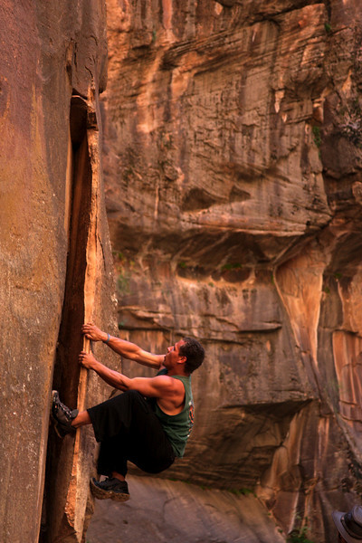 Kelsey finds a bit of climbing on the walls of the canyon.