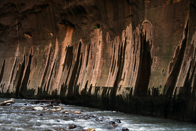 Natural water streaks make beautiful art on the sandstone walls, hundreds of feet below the surface sandstone where this water was originally deposited.