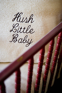 Hush little baby throw pillow in crib