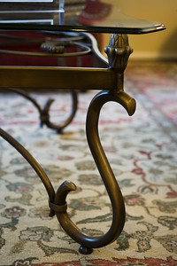 Detail s shaped leg of glass coffee table
