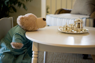 Childrens stuffed animals having tea party