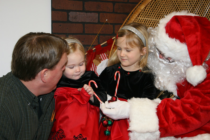 Ashleigh went up to see Santa with Daddy; the candycane helped!