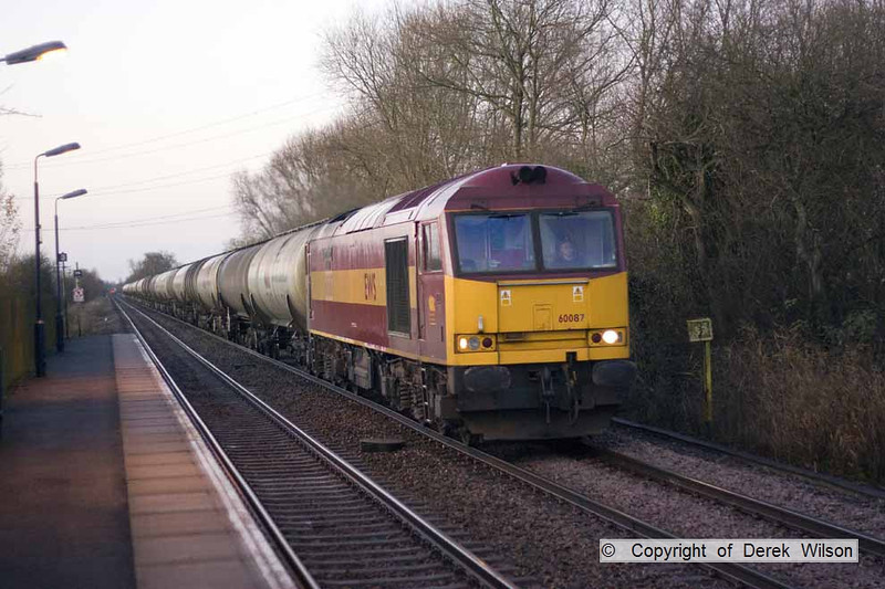 081206-003     Caught in some early morning winter's light is EWS class 60 no. 60087 Barry Needham, seen passing Thurgaton, powering train 6E46 Kingsbury - Lindsey, emty fuel-oil tanks.