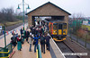 081214-002     On Sunday 14th December 2008, with the start of the winter timetable, the Robin Hood Line recieved it's first Sunday service. The first train was formed by class 153 units no's 153374 & 153319 and operated from Nottingham to Mansfield Woodhouse. It is seen here after arriving at Mansfield Woodhouse where it was welcomed by Robin Hood & his merry band, which included dignitaries from the local councils & East Midlands Trains etc. The units left as the 08.37 Back to Nottingham.