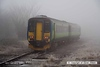 080219-023     East Midlands Trains 'Central' green class 156 unit no 156411 disappears back into the freezing fog as it heads away from Netherfield with the 08.50 Nottingham to Skegness.