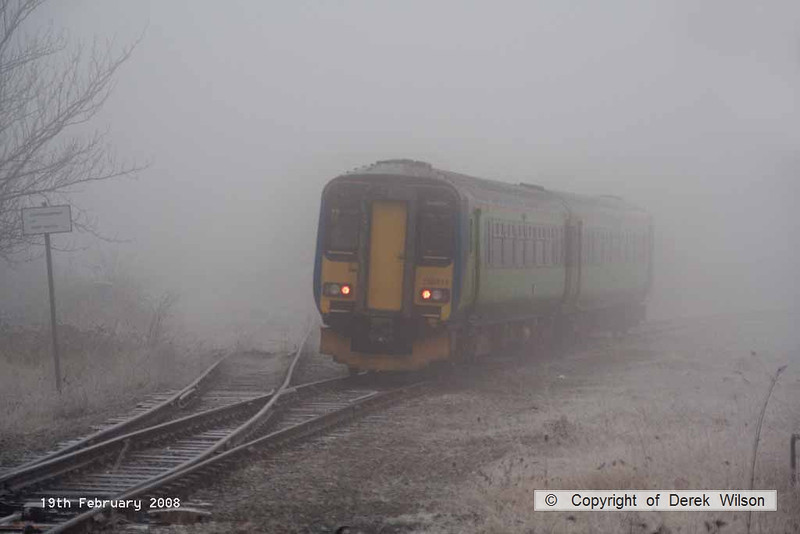 080219-024     East Midlands Trains 'Central' green class 156 unit no 156411 disappears back into the freezing fog as it heads away from Netherfield with the 08.50 Nottingham to Skegness.