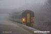 080219-005     On a bitterly cold morning, with dense freezing fog, Central green class 158 unit no 158858 crawls through Netherfield with the 07.52 Nottingham to Norwich.
