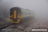 080219-006     Central green class 158 unit no 158858 disappears into the freezing fog, as it passes Netherfield with  the 07.52 Nottingham to Norwich.