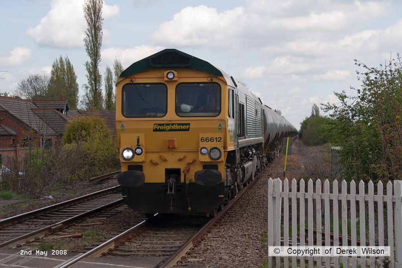 080502-015     Freightliner class 66/6 no 66612 Forth Raider is captured passing through Burton Joyce, near Nottingham, powering train 6M00 Humber oil refinery to Kingsbury, loaded (fuel-oil) bogie tanks.