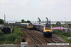 080628-007     First Great Western class 43 no. 43164 leads the 16.06 Paddington - Penzance through the down loop at Dawlish Warren, as it passes 66622 which has been stopped on the main. The unusual scene was captured after 66622 was stopped to allow 159016 to pass after calling at the station.