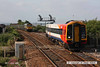 080628-005     Southwest Trains class 159 unit no. 159016 pulls away from Dawlish Warren with the 18.15 to Paignton. On the up main is 66622 powering 6Z66 Reading yard - Newton Abbot hauling a rake of empty FHH box wagons. It was held to let the unit past, afterwards a FGW HST also passed through the loop before it was released.