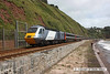 080705-008     A East Coast HST set on hire to Cross Country Trains poses in the sun at Teignmouth, near Parsons tunnel. It was held for around thirty minutes due to storm damage to the sea wall at Dawlish. Powercar 43302 is seen at the rear of the 10.32 Paignton - Newcastle, whilst 43051 is in the distance, at the front.
