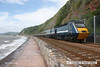 080705-010     A East Coast HST set on hire to Cross Country Trains poses in the sun at Teignmouth, near Parsons tunnel. It was held for around thirty minutes due to storm damage to the sea wall at Dawlish. Powercar 43051 is seen at the front of the 10.32 Paignton - Newcastle, whilst 43302 is in the distance, at the rear.