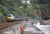 080705-013     A National Express East Coast HST set powered by 43051 (front) & 43302 (nearest) is seen about to enter Parsons tunnel at Teignmouth with a delayed 10.32 Paignton - Newcastle, Cross Country Trains service.