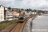 080706-001     A pair of First Great Western class 142 pacer units, with 142030 at the front, seen passing the scenic sea wall at Dawlish with the 10.10 Exeter St Davids - Paignton.