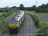 228 at the rear of the 0830 Cork - Heuston which is about to descend Ballybrophy Bank. Sun 31.08.08