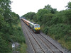 221 is seen near Ballybrophy with the 0715 Tralee - Heuston service. Sun 31.08.08