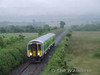 In terrible weather 2707 + 2708 pass Sixmilebridge with the 1245 Limerick - Ennis. Wed 18.06.08