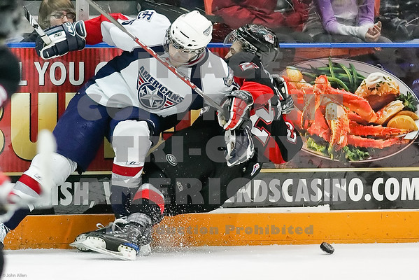 Americans Neal Prokop and Cougers Art Bidlevskii have dinner over a puck on the ice