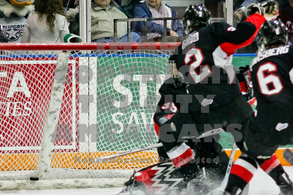 Americans Adam Hughesman slamed this puck into the net in the 2nd period to tie the game with 44.5 sec left in the period