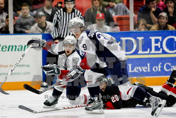 Neal Prokop and Brock Sutherland stop Cougars Alex Rodgers mid ice