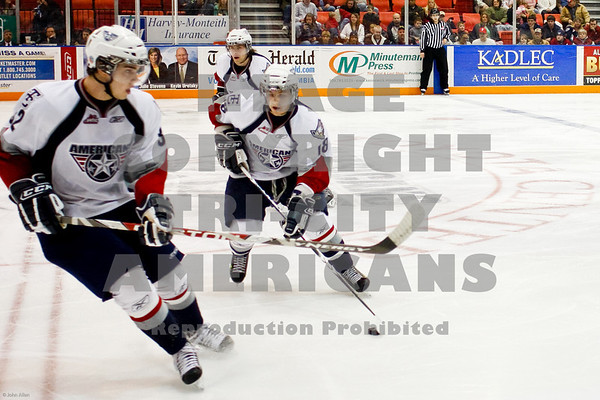 Todd Kennedy and Mason Wilgosh gain control of the  puck
