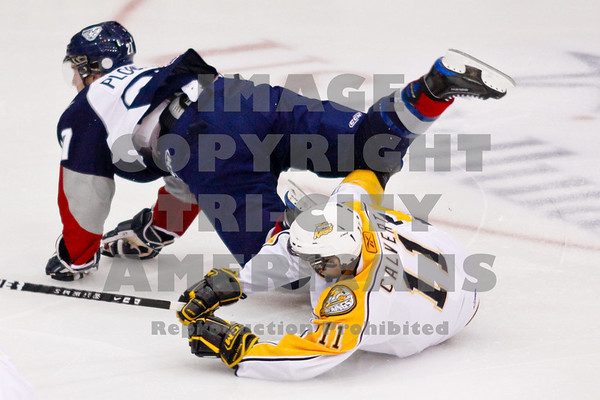 Brett Plouffe and Matt Calvert collide in the 1st period and land on the ice