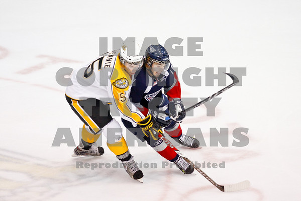 Kruise Reddick and Scott Glennie have some togeather time going for the puck