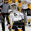 Americans Bendan Shinnimin is pulled down to he ice from behind by Wheat Kings Colby Robak afer a play in the 1st period