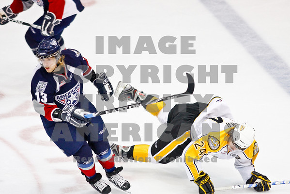 Sergei Drozd makes the turn to the puck and Jay Fehr hits the ice