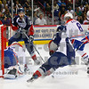 Americans Patrick Holland and Neal Prokop  in the 1st period are foiled in their goal attempt by Chiefs goalie James Reid, Brenden Kichton, and Jared Cowen