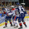 Americans Neal Prokop  and Jordan Messier struggle with Chiefs Stefan ulmer for the puck  behind the goal