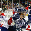 Americans Tyler Schmidt folled closely by Chiefs Mitch Wahl  pursue the puck in the 1st period