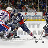Americans goalie Drew Owsley with assistance from Jarrett Toll and Tyler Schmidt stop a goal attempt by Chiefs Kyle Beach