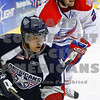 Americans Zachary Yuen is chased by Chiefs Kyle Beach around the back of the net